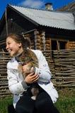 Beautiful smiling girl pets a puppy Stock Photos