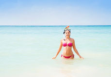 Beautiful, smiling girl in pink bikini diving in the sea Stock Photography