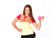 Beautiful smiling girl with pink dumbbells Stock Images