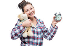 Beautiful smiling girl in plaid pajamas with a bead Royalty Free Stock Photo