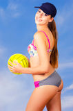 Beautiful smiling girl playing beach volleyball Royalty Free Stock Photo