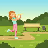 Beautiful smiling girl playing flute while walking in city park, kids outdoor activity vector illustration. Web banner Stock Image
