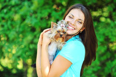Beautiful smiling girl portrait with puppy yorkshire terrier Stock Image