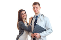 Beautiful smiling girl put her hand on the shoulder of a young doctor in a white lab coat. Is on a white background royalty free stock photo