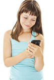 Beautiful smiling girl reading sms on your cell phone Royalty Free Stock Photography