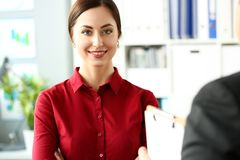 Beautiful smiling girl in red blouse at workplace look in camera. Portrait. White collar dress code worker at job offer modern lifestyle client visit study royalty free stock photography