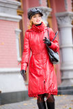 Beautiful smiling girl in red coats and hat Stock Images