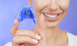 Beautiful Smiling Girl with Retainer for Teeth, Close-up Royalty Free Stock Photo