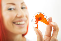 Beautiful Smiling Girl with Retainer for Teeth, Close-up. Beautiful Smiling Redhead Girl Holding red Retainer, Braces for Teeth. Orthodontics Dental Theme Royalty Free Stock Image