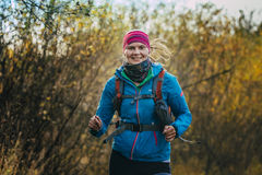 Beautiful smiling girl running in autumn forest Royalty Free Stock Photos