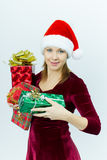 Beautiful smiling girl in Santa hat with presents Royalty Free Stock Photo