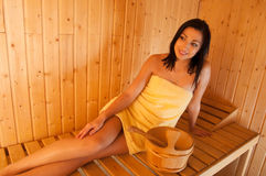 Beautiful smiling girl in sauna Stock Photos
