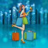 Beautiful smiling girl with shopping bags and gift cards. Sales Night in the glittering city Stock Image