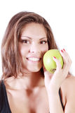 Beautiful smiling girl shows fresh green apple Royalty Free Stock Photos