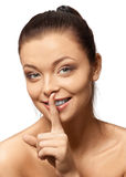 Beautiful  smiling girl with silence sign Stock Image
