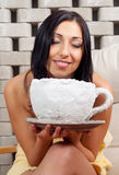 Beautiful smiling girl sitting in the salt room Stock Photo