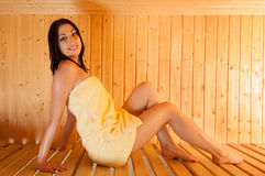 Beautiful smiling girl sitting in sauna Royalty Free Stock Photography