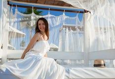 Beautiful smiling girl  sitting under white baldachin Royalty Free Stock Image
