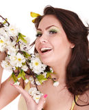 Beautiful  smiling girl with spring flower. Stock Photo