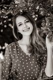 Beautiful smiling girl stay near apple tree royalty free stock photography