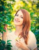 Beautiful smiling girl stay near apple tree stock photos