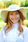 Beautiful smiling girl on summer day in hat. Beautiful smiling girl on summer day Stock Images