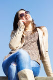 Beautiful smiling girl talking on mobile phone Royalty Free Stock Image