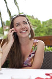 Beautiful smiling girl talks on cellular telephone Stock Photos