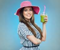 Beautiful smiling girl wearing striped dress  holding detox gree Stock Images