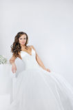 Beautiful smiling girl in a white wedding dress Royalty Free Stock Photography