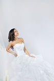 Beautiful smiling girl in a white wedding dress Stock Photography