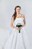 Beautiful smiling girl in a white wedding dress Stock Photos