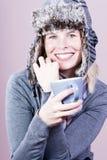 Beautiful smiling girl in a winter cap. Stock Image