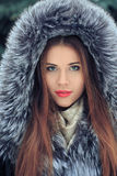 Beautiful smiling girl . Winter portrait. fur hood Royalty Free Stock Photography