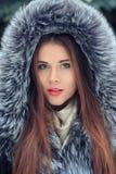 Beautiful smiling girl . Winter portrait. fur hood Stock Photos