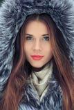 Beautiful smiling girl . Winter portrait. fur hood Royalty Free Stock Photo