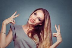 Beautiful smiling girl woman showing peace gesture. Isolated on royalty free stock photos