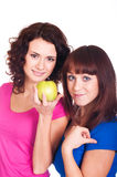 Beautiful smiling girls with apple Stock Images