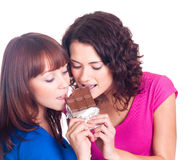 Beautiful smiling girls with  chocolate Royalty Free Stock Photography