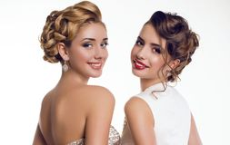 Beautiful smiling girls  in elegant dresses Royalty Free Stock Image