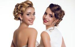 Beautiful smiling girls  in elegant dresses Royalty Free Stock Image