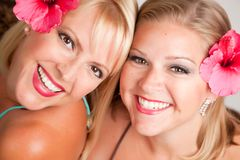 Beautiful Smiling Girls with Hibiscus Flowers Royalty Free Stock Image