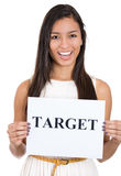 Beautiful smiling, happy businesswoman holding a sign which says target Stock Image