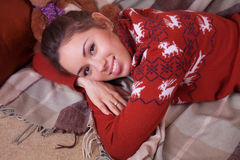 Beautiful smiling happy girl in a sweater Royalty Free Stock Photo