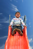 Beautiful smiling(happy) indian boy(kid) on slider in summer Royalty Free Stock Photo