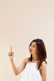 Beautiful smiling happy positive woman pointing her hand up Royalty Free Stock Photo