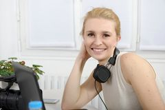Beautiful smiling happy woman with headphones Stock Photos