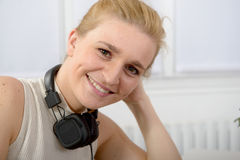 Beautiful smiling happy woman with headphones Stock Image