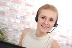 Beautiful smiling happy woman in headset Stock Image