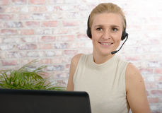 Beautiful smiling happy woman in headset Royalty Free Stock Images